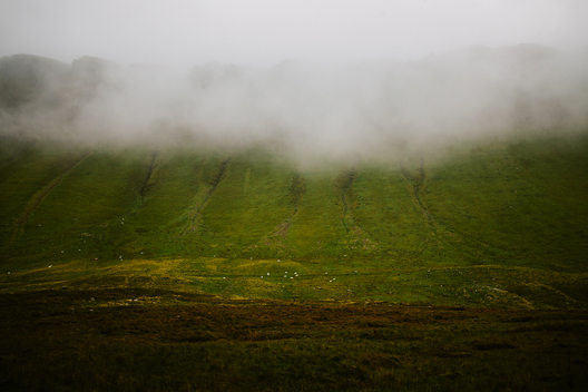 Benbulben detailed view with sheep on a cloudy day, county Sligo, Republic of Ireland, Europe.