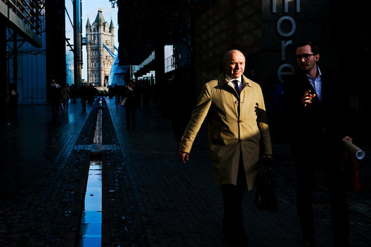 London Businessmen walking through the business district near Tower Bridge, Thames river, UK, editorial photographers, travel, Europe