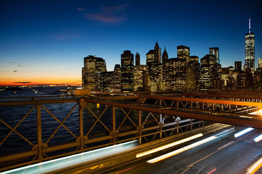 Partial New York skyline at sunset from the Brooklyn Bridge.