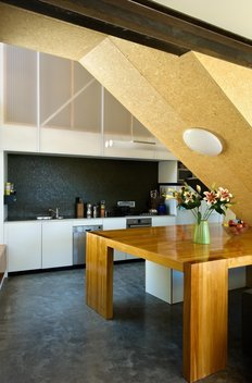 A rich selection of materials and generous height in the kitchen space