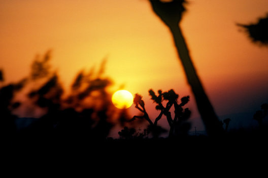 The sun sets into the horizon on a hot Sonoran Desert evening.