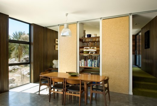 a level change and sliding doors and shelving seperate spaces